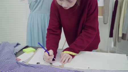 satysfakcja : Professional beautiful Asian female fashion designer working measuring dress on a mannequin clothing design at the studio. Lifestyle women working concept. Wideo