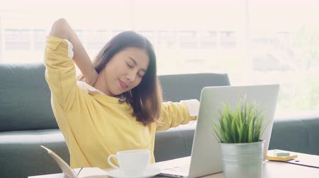 boring : Business freelance woman stretching her body because feel tired after working on laptop, smart female working at home. Lifestyle women relax after working at home concept. Stock Footage