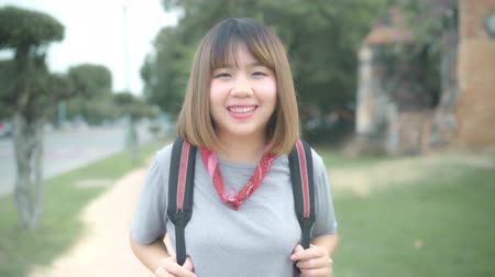 иероглиф : Slow motion - Traveler Asian woman feeling happy smiling to camera holiday trip at Ayutthaya, Thailand, backpacker female enjoy his journey at amazing landmark in traditional city. Стоковые видеозаписи