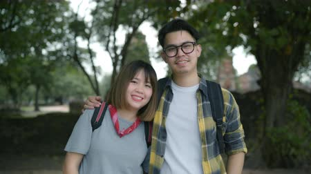 иероглиф : Traveler Asian couple feeling happy smiling to camera holiday trip at Thailand, backpacker sweet couple enjoy their journey at amazing landmark in traditional city. Portrait looking at camera.