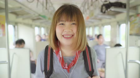 passeio público : Traveler Asian woman walking and looking for seat while taking a train, Young female tourist backpacker journey in Thailand. Lifestyle teen women travel concept. Stock Footage