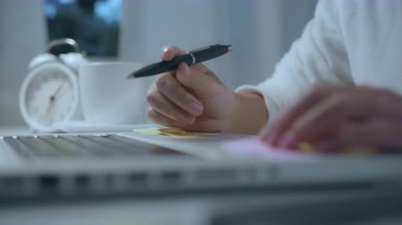 księgowa : Young asian woman working late using laptop on desk in living room at home. Asia business woman writing notebook document finance and calculator in night at home office. Enjoying time at home concept. Wideo