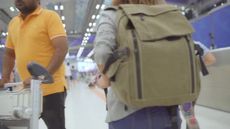 сумки : Slow motion - Young Asian backpacker woman walking in terminal hall while going to boarding flight at the departure gate in international airport. Lifestyle backpack tourist travel holiday concept.