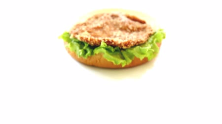 нездоровое питание : Close-up homemade burger on white background  Стоковые видеозаписи