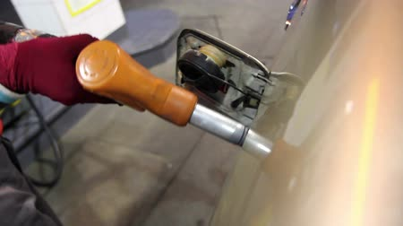 petrol : Service of Refueling Car At Retail Gasoline Station