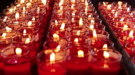 bodhnath : Rows of burning candles at the Chinese temple Stock Footage