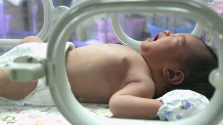 newborn child : Crying newborn baby in Incubator care at nursery