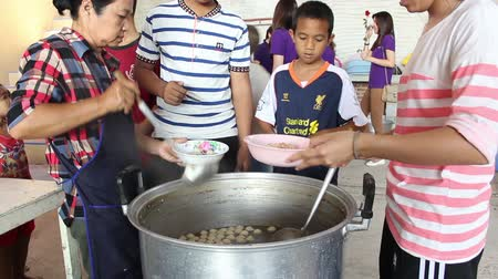 family life : Orphans living in Temple getting free lunch from Philanthropists. Stock Footage