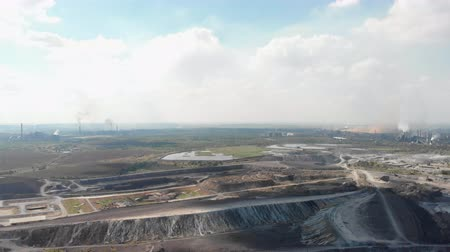 Panorama of fuming plants and quarry