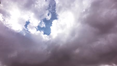 evaporate : White clouds disappear in the hot sun on blue sky. Time-lapse motion clouds blue sky background. Blue sky. Clouds.