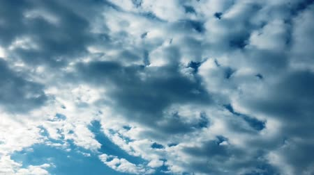 evaporate : White clouds disappear in the hot sun on blue sky. Time-lapse motion clouds blue sky background.