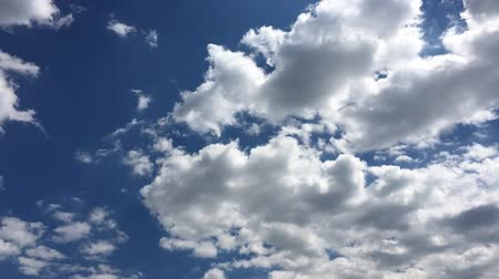 evaporate : White clouds disappear in the hot sun on blue sky. Time-lapse motion clouds blue sky background. Blue sky. Clouds. Blue sky with white clouds. Blue sky. Clouds. Blue sky with white clouds. Stock Footage