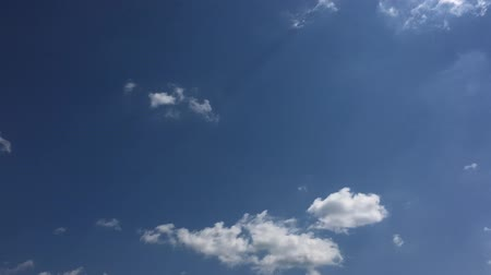 evaporate : White clouds disappear in the hot sun on blue sky. Time-lapse motion clouds blue sky background. Sky with clouds weather nature cloud blue. Blue sky with clouds and sun.