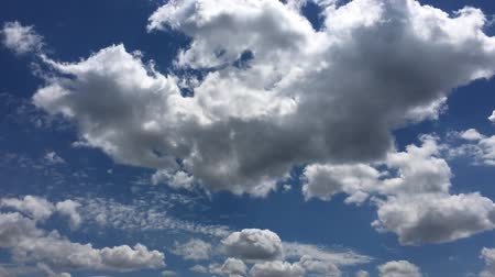 atmosphere : White clouds disappear in the hot sun on blue sky. Time-lapse motion clouds blue sky background. Blue sky. Clouds. Blue sky with white clouds.
