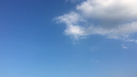 evaporate : White clouds disappear in the hot sun on blue sky. Time-lapse motion clouds blue sky background. Blue sky. Clouds. Blue sky with white clouds.