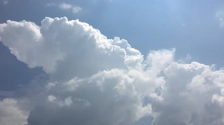 evaporate : White clouds disappear in the hot sun on blue sky. Time-lapse motion cloud blue sky background. Blue sky with white clouds and sun. Stock Footage