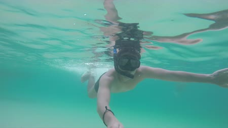 Man snorkeling in clear shallow sea. Thailand Stok Video