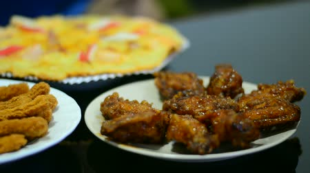 Pizza set and chicken snack on the table serve for meal Stok Video
