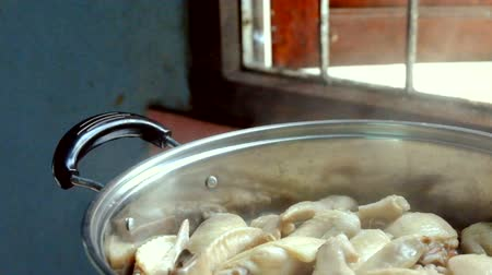 Cooking chicken wing steam in a pot motion scene