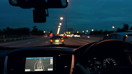 Driving a car on the night road with navigator.