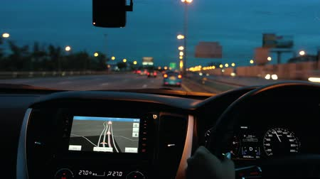 érzékelő : Driving a car on the night road with navigator.