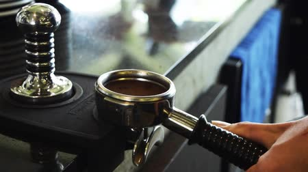 Barista preparing and Tamping ground coffee