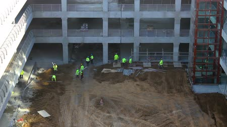 higher : A group of construction workers working Stock Footage