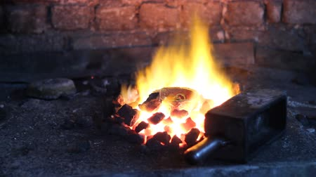 irony : Smelting scrap metal jewelry in blacksmith workshop Stock Footage