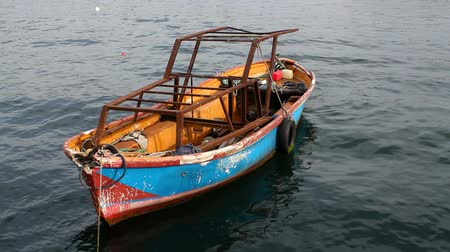 marinado : Small old boat on the sea