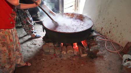kotel : Traditional making tomato paste in boiler with wood fire in the village