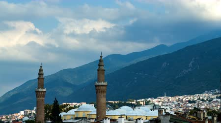 Bursa Ulu Mosque Mosque minaret and Uludag Mountain view. Time lapse video