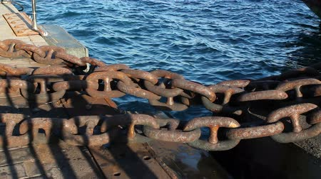 navy pier : Big iron chain. Chain tied to ship pier Stock Footage