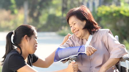 rokkant : Young asian woman is taking care the senior woman patient in Thailand