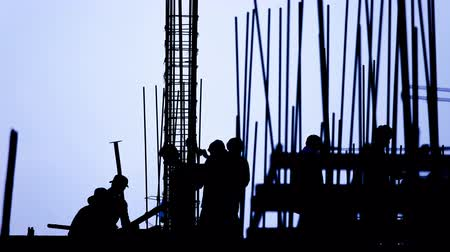 гражданский : Time lapse - construction worker silhouette on the work place Стоковые видеозаписи