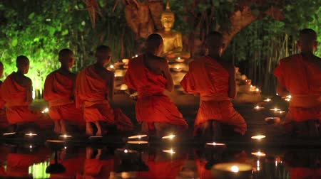 szerzetes : CHIANG MAI THAILAND  JUNE 1 : Visakha Bucha Day is the most important incidents Buddhist day. Buddhist monk fire candles to the Buddha. Jun 12015 in Phan Tao Temple Chiangmai Thailand.