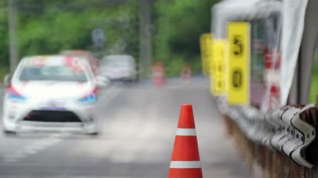 гонка : orange traffic cones on the race car track