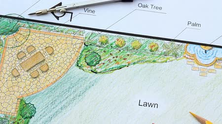 drafter : Landscape architect design L shape garden plan, panning right Stock Footage