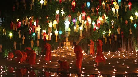 peng : CHIANG MAI THAILAND - NOVEMBER 25 : Yee-Peng festival is an important culture in Thailand, Monk light a candles to pray the Buddha. Nov 25,2015 in Phan Tao Temple, Chiangmai, Thailand.