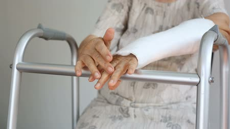 elenco : senior woman broken wrist using walker
