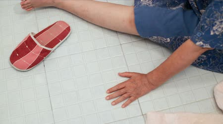 fall down : elderly falling in bathroom because slippery surfaces