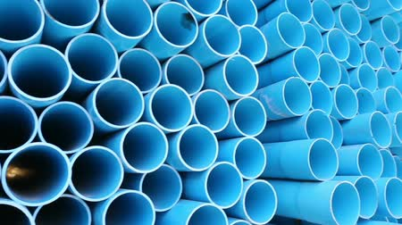 culvert : PVC pipes stacked in warehouse.