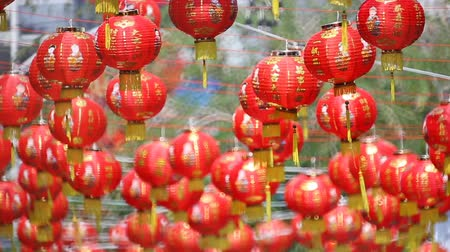 Новый год : Chinese new year lanterns with blessing text mean happy ,healthy and wealth in china town. Стоковые видеозаписи