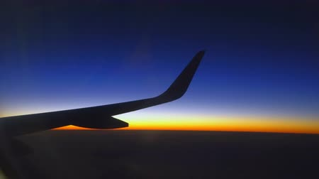trave : Wing of plane on sunset sky Stock Footage