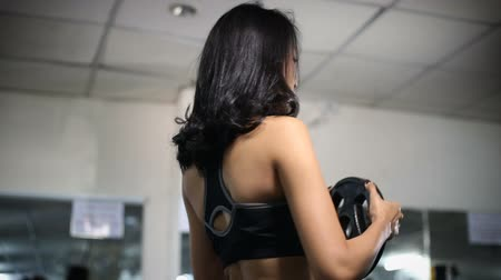 sağlam : Asian woman exercise with dumbbells in gym