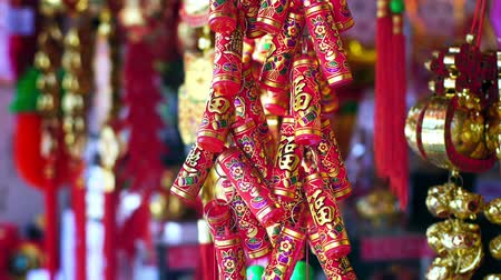 chinese lantaarn : Chinese New Years decorations and fake firecrackers words mean best wishes and good luck Stockvideo