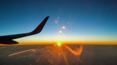 trave : Wing of plane on sunset sky and clouds