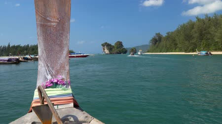 aonang : Long tail boat left port nopparat thara beach heading to poda island ,Krabi Thailand.