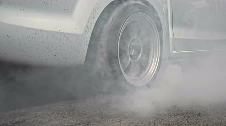 dragging : Drag racing car burns rubber off its tires in preparation for the race Stock Footage