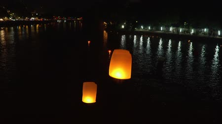 balões : floating sky lanterns at ping river in Chiang Mai ,Thailand