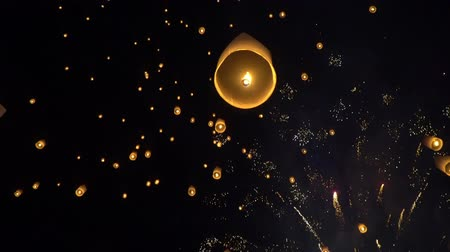 firecracker : Floating New Year sky lanterns in Chiang Mai ,Thailand. Stock Footage